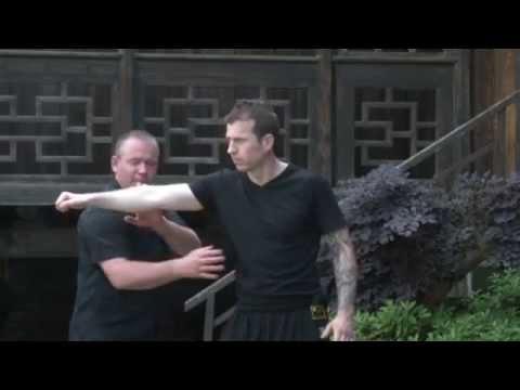 Sifu Burton and Master Yue teach the Five Thunder Dim Mak point Zhang Men