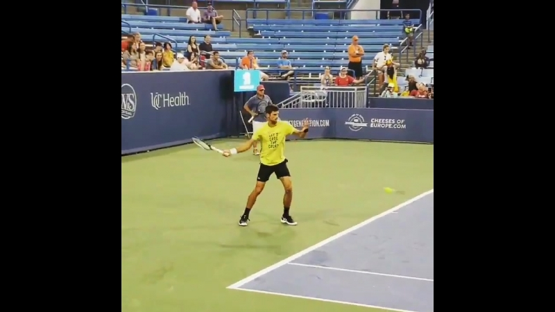 Novak Djokovic hitting with David Goffin on the Grandstand at the @CincyTennis.