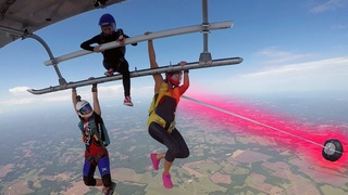 Friday Freakout: Skydiver's Handle Caught On Helicopter, Reserve Parachute Deploys While Hanging!