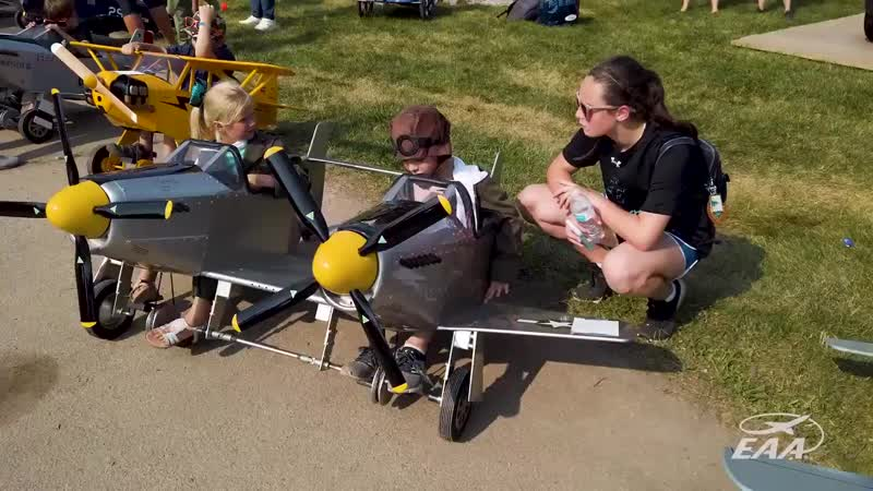 Kids at AirVenture had a fun time yesterday pedaling down Celebration Way in a v 720 X 1280 mp4