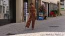 Amputee Nina walking with her empty pantleg hanging loose