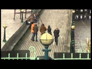 Liam waving and Harry walking on the pier in Clevedon yesterday!