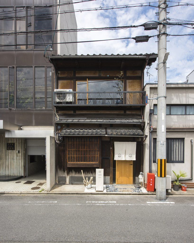 td-atelier's renovation of a japanese guesthouse combines traditional architectural elements with modern interventions.