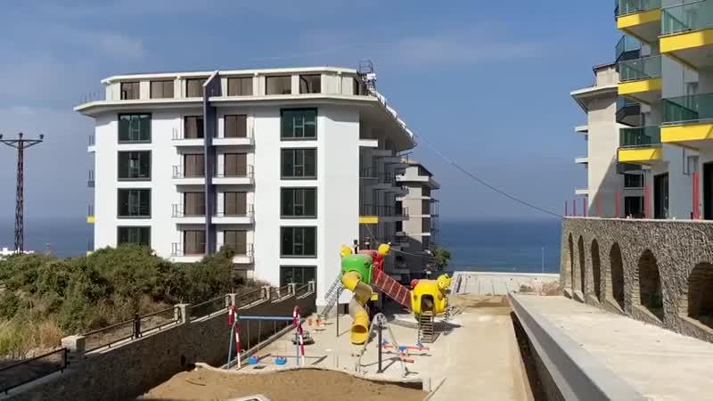 Обзор строящегося жилого комплекса на первой береговой линии в Алании Турция 720p